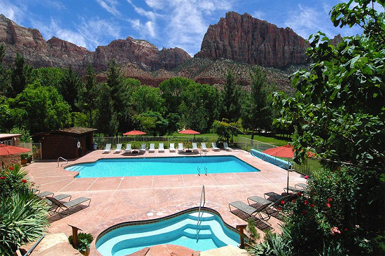 Relax poolside at the Cliffrose Lodge